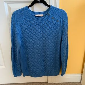 Blue cable knit pullover with gold logo buttons